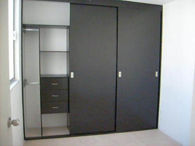 Closets de madera closets modernos bogot closets madera - Puerta corrediza madera ...